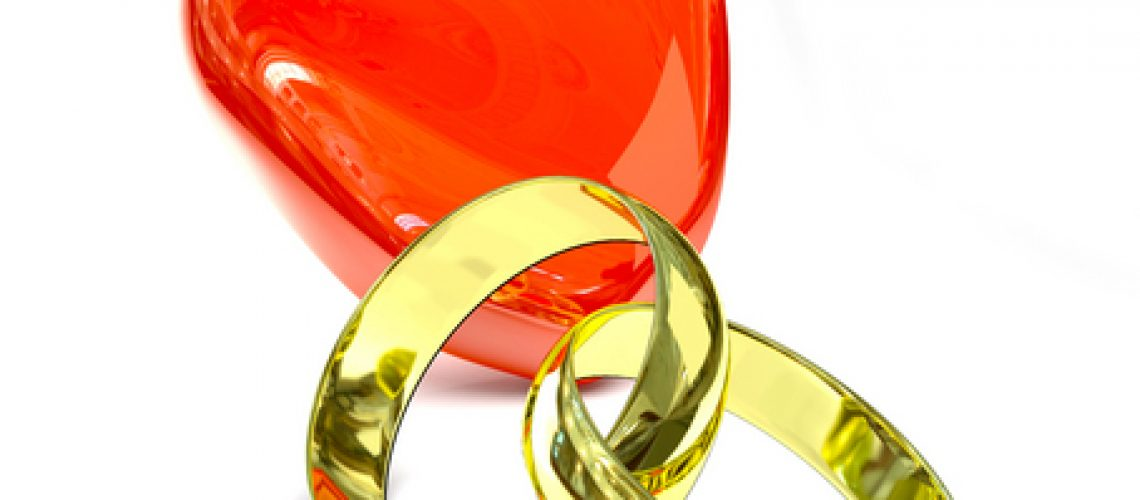 Two gold rings over white background